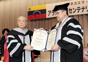 UBA Rector Guarisma presents Mr. Ikeda with the certificates of honorary doctorate