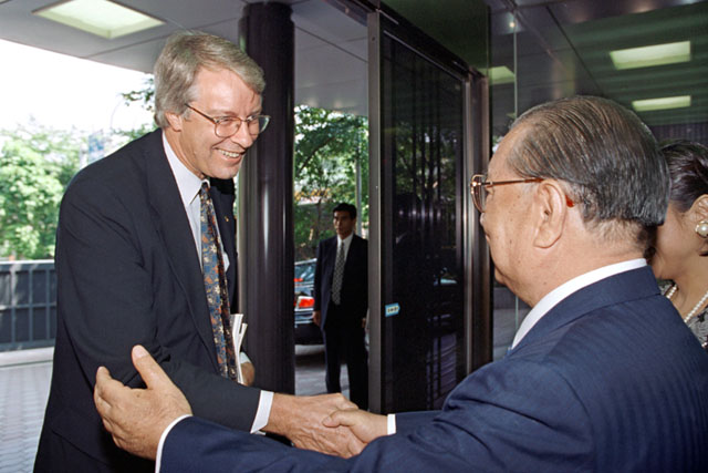 Dr. Clements being greeted by Mr. Ikeda (Tokyo, July 1996)