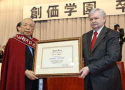 Mr. Likhanov (right) presents Mr. Ikeda with the certificate naming him