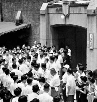 Soka Gakkai members greet Ikeda after his release from the Osaka detention house on July 17, 1957